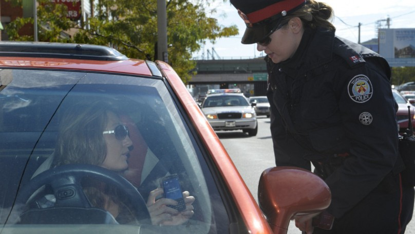Driver whips out phone in pulled over car, gets another ticket. Were police in the wrong?