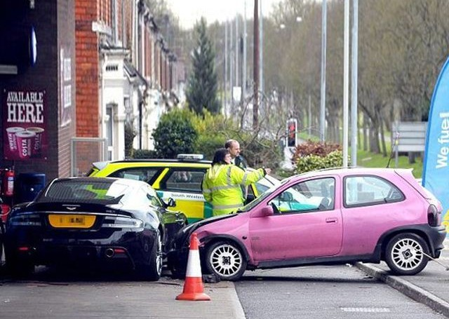 Pink beater wrecks Aston Martin after roundabout error