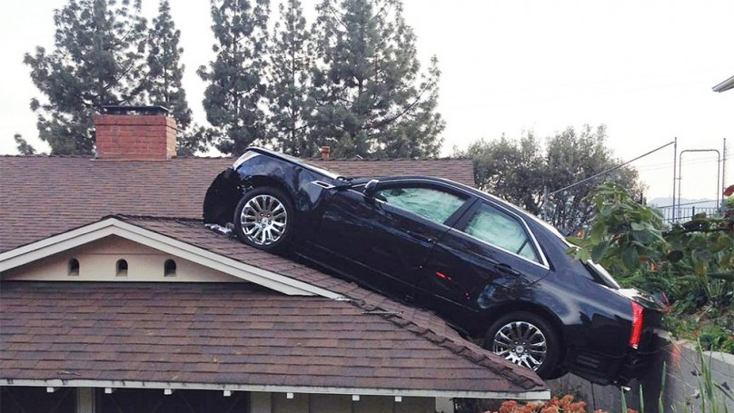 Man's Cadillac ends up on neighbour's roof in bizarre accident