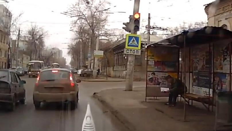 Russian dash-cam captures officer<br> calmly crashing into bus stop
