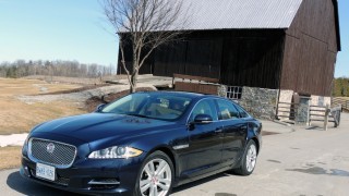 Jaguar XJL 2015 front view in front of a barn