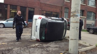 Smart Car tipped on it's side