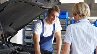 mechanic helping customer with engine repair