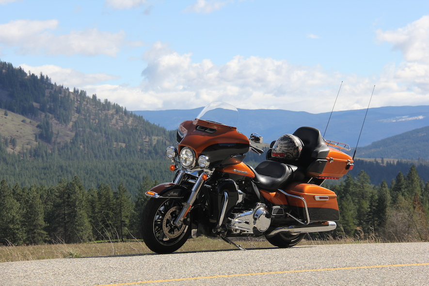 Harley Davidson Motorcycle in front of picturesque Okanogan Valley in BC
