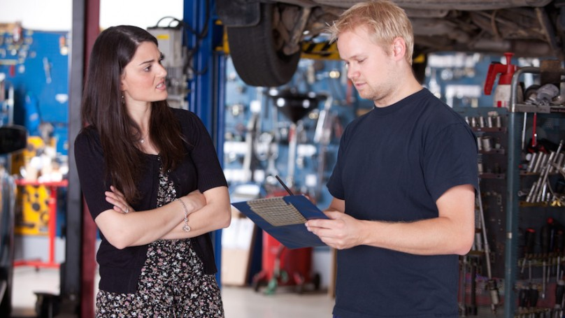 Mechanic with frustrated customer