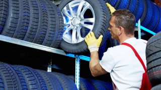 Car mechanic stores winter tires for tire changing