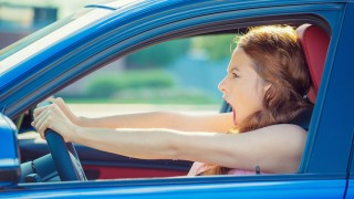 displeased angry pissed off aggressive woman driving car shouting screaming