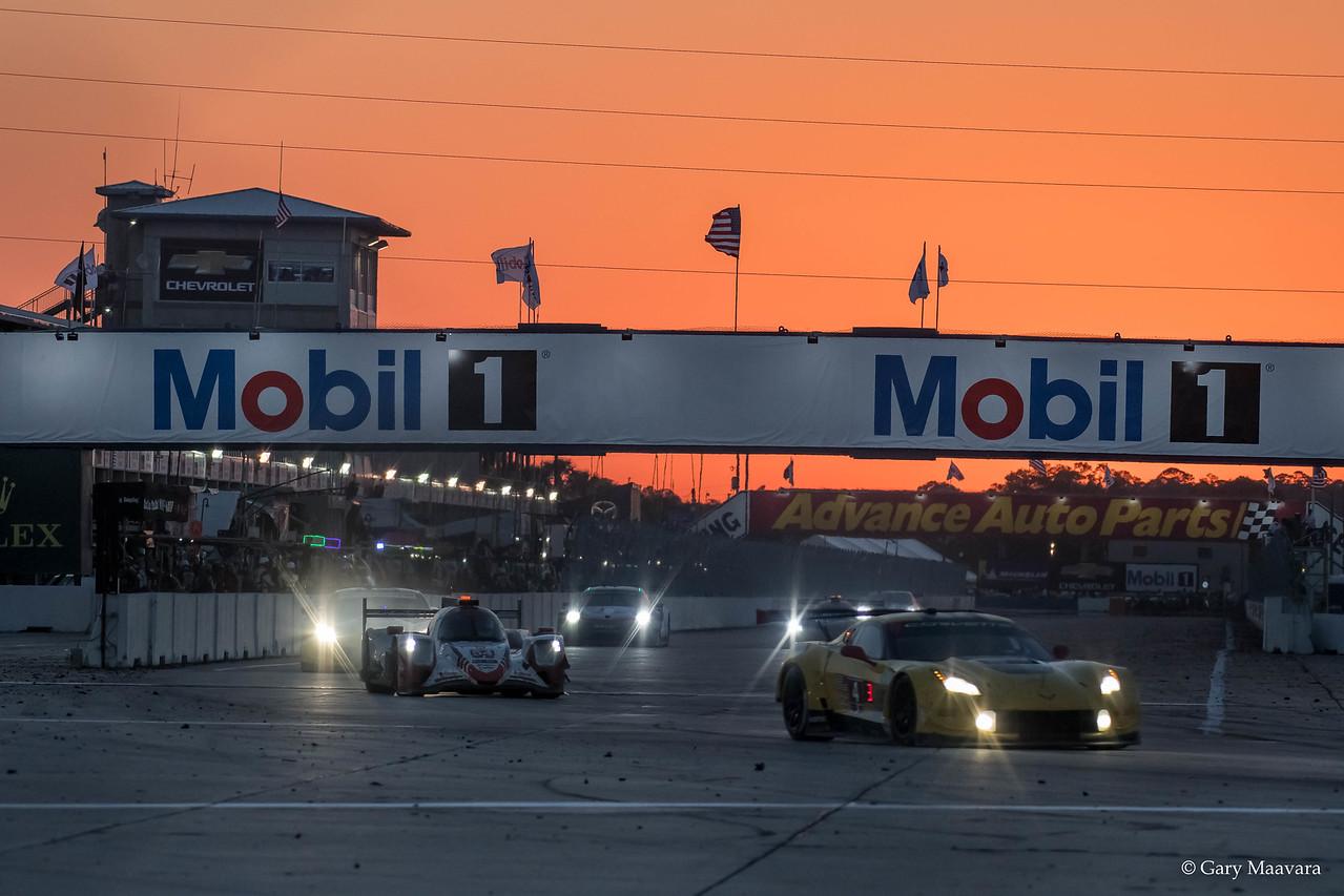 TrackWorthy - Weathertech race hour nine turn one twilight Corvette