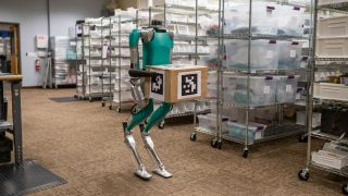 Robots to Work with Humans at Ford